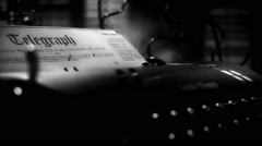 Film noir telegraph in a typewriter closeup Stock Footage