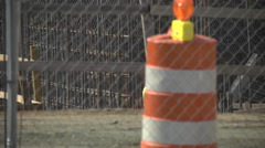 Construction site and traffic cone telephoto Stock Footage