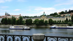 Vltava river with prague castle and government office in prague Stock Footage