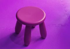small pink plastic stool for kids isolated on soft floor indoor playground - stock photo