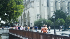 Looking towards the Notre Dame while people walk past Stock Footage