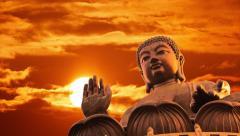 Tian Tan Buddha statue over sunset sky background. Lantau Island, Hong Kong. Stock Footage
