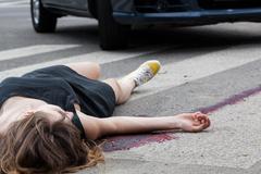 Woman hit by a car Stock Photos