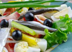 nicoise salad with anchovies - stock photo