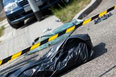 Car accident and corpse in bag Stock Photos