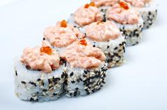 Spice sushi with sauced slices Stock Photos