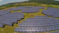 Aerial  view over photovoltaic solar units  producing renewable energy - stock footage