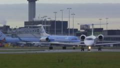 Small jet airplanes taxiing out on airfield to the runway Stock Footage