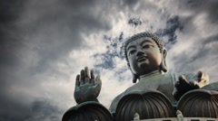 Tian Tan Buddha statue storm cloudy sky background. Lantau Island, Hong Kong. Stock Footage