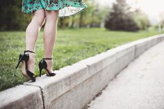 Woman legs and high heels Stock Photos