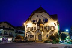 statue of mozart and townhall at night in st. gilgen - stock photo