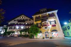 guesthouses and motels at night in st. gilgen - stock photo