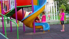 Children playing in the playground with slides. Stock Footage