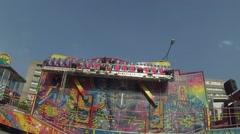 Amusement park. Platform, ornate, revolve visitors vertically. Stock Footage