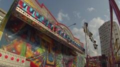 Stock Video Footage of amusement park. Platform, ornate, revolve visitors vertically.