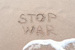 handwriting stop war on the sandy beach - stock photo