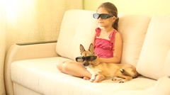 little girl watching TV in stereo glasses - stock footage