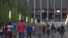 Big football soccer match in town all fans coming to stadium arena crowded place - stock footage