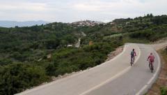 Couple riding mountain bikes Stock Footage