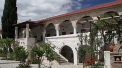Colonnade and backyard of Greek monastery Stock Footage
