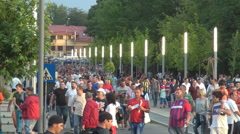 Men and women football soccer fans, coming to the arena, crowded place in town Stock Footage