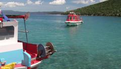 POV of boat leaving bay with crystal waters Stock Footage