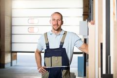 Portrait of craftsman on shop floor Stock Photos