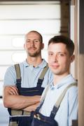 Portrait of two craftsmen on shop floor Stock Photos
