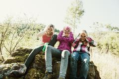 Three girls exploring the nature - stock photo