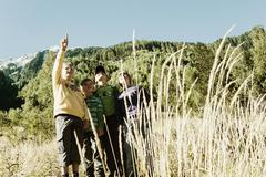 Four boys exploring the nature - stock photo