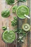 Green vegetable and fruit smoothie with spinach, salad, parsley, cress, oregano Stock Photos