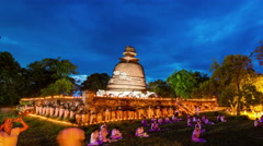 Candle light trail of Buddhism Ceremony at wat mahaeyong temple ayutthaya ruin Stock Footage