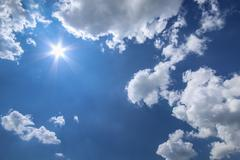 blue sky sun and white clouds - stock photo