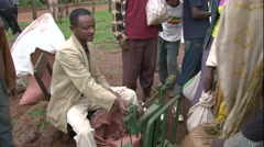 African tradesman using scale, weighing product at African market Stock Footage