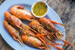grilled shrimps on white plate - stock photo
