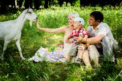 goat and family on picnic - stock photo