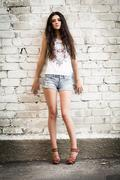 Girl against the wall Stock Photos