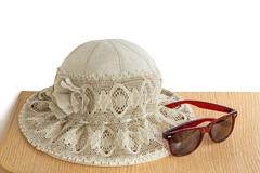 female summer hat for protection against the sun on a white background. - stock photo