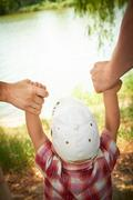 in parents hands - stock photo