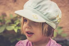 Portrait of astonished little girl Stock Photos