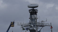 Sailord fixing wind air speed meter on warship mast Stock Footage