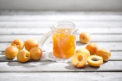Apricot jam and apricots, Prunus Armeniaca - stock photo
