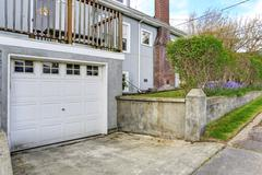 house backyrd with garage and driveway view - stock photo