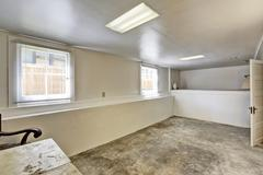 old empty basement room with concrete floor - stock photo