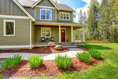 countryside house exterior. view of entrance porch and curb appeal - stock photo