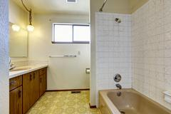 Empty bathroom interior in old house Stock Photos