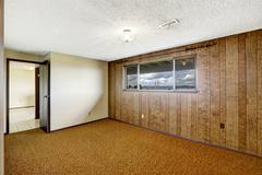 empty room with wood plank paneled wall and view of gig harbor bridge - stock photo
