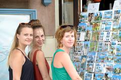 Stock Photo of three young women make tourism in annecy
