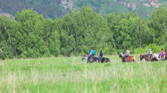 Group of riders in the hills Stock Footage