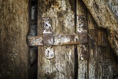 old latch on the old wooden door. - stock photo